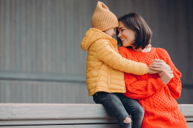 Shot of affectionate young woman in warm red sweaterromotion Premium Photo