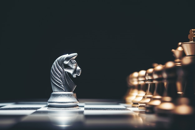 Shot of a chess board silver horse moving. Premium Photo