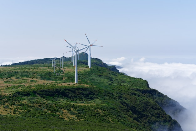 Shot of wind turbines on the mountains Free Photo