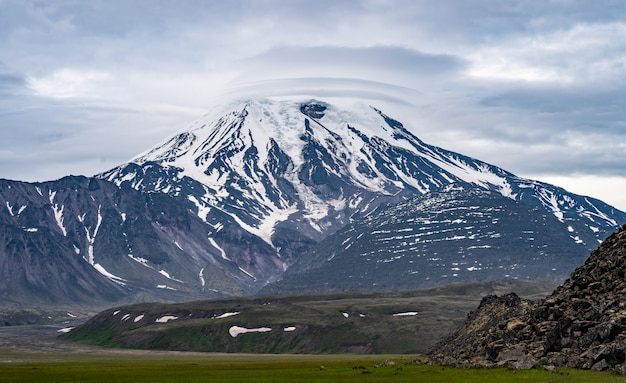 Show volcano view with blue sky and cloud background Premium Photo