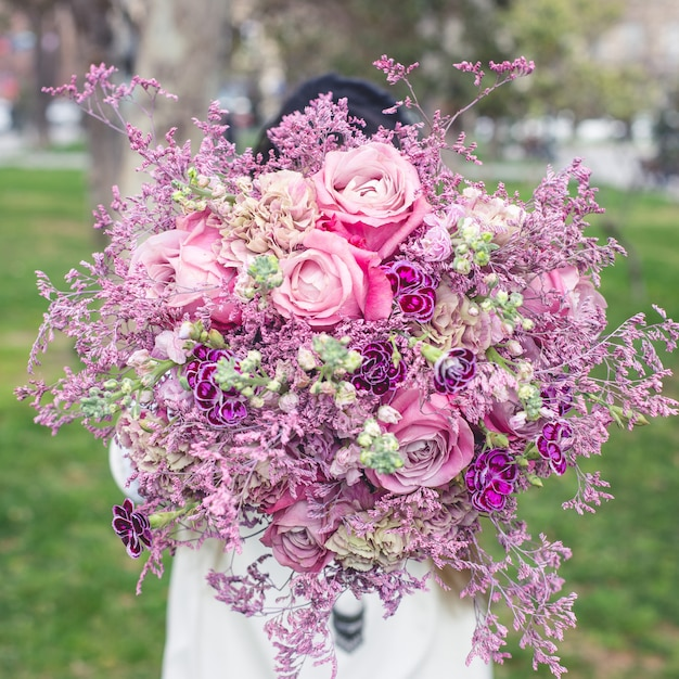 Showing a purple bouquet of flowers in the garden Free Photo
