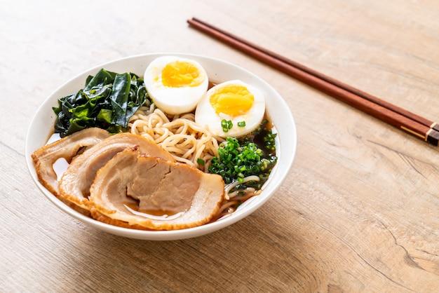 Shoyu ramen noodle with pork and egg Premium Photo