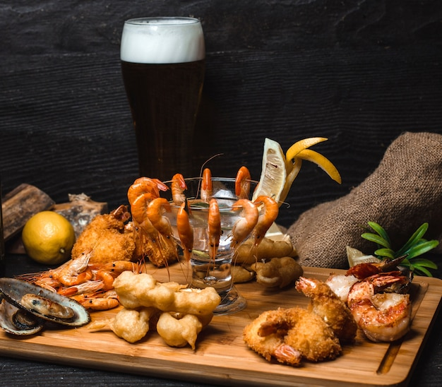Shrimp in batter and fried shrimp on a wooden board Free Photo