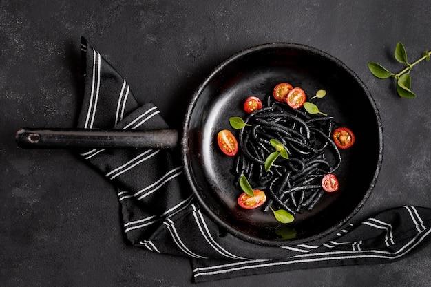 Shrimp black pasta and kitchen napkin Free Photo