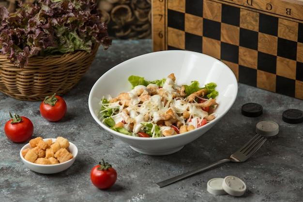 Shrimp caesar salad on the table Free Photo