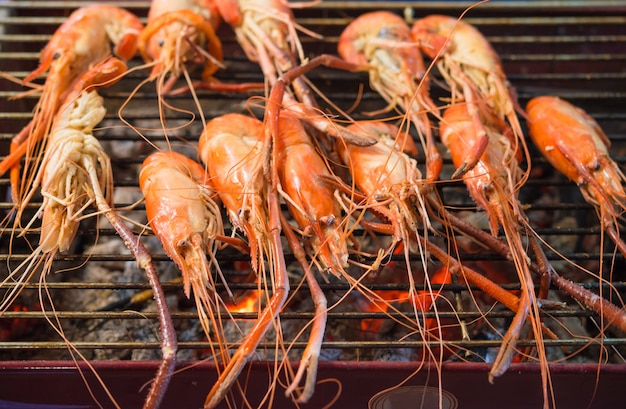 Shrimp grilled bbq seafood on charcoal stove for sale at thai street