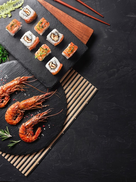 Shrimp with sushi on stone table Premium Photo
