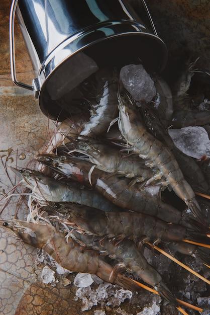 Shrimps or prawns and ice bucket. Premium Photo