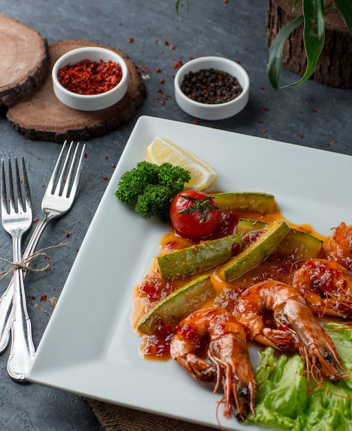 Shrimps under sauce with vegetables top view Free Photo