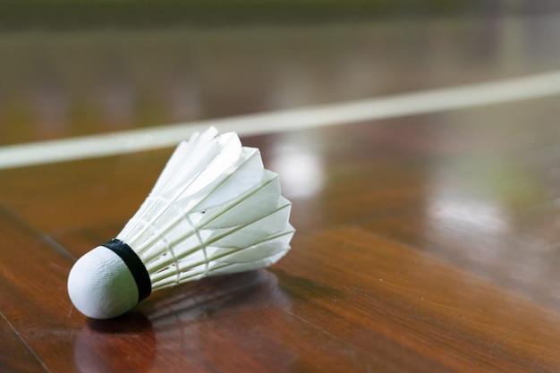 Shuttle cock on the badminton court Premium Photo