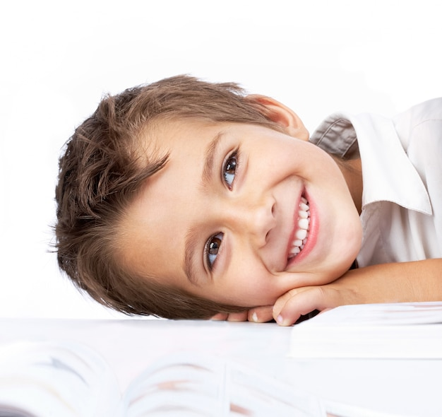 Shy little boy with an open book Free Photo