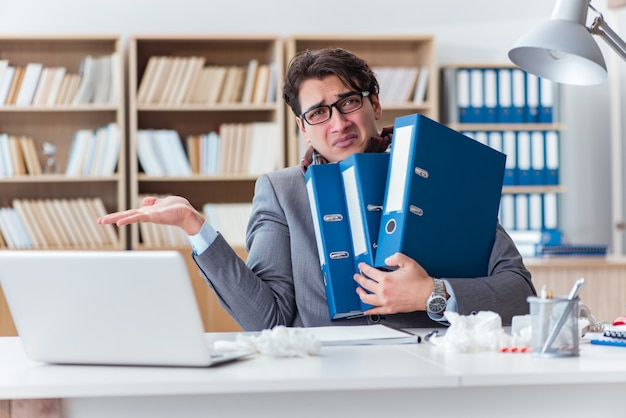 Sick businessman suffering from illness in the office Premium Photo