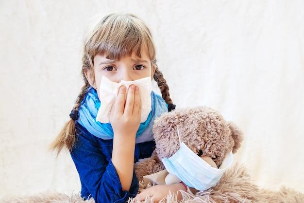 Sick child girl. prescribe treatment. selective focus. Premium Photo