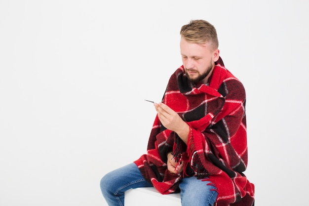Sick man measuring temperature Free Photo