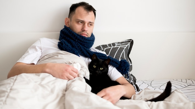 Sick person indoors with scarf Free Photo