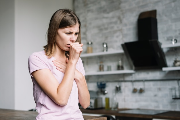 Sick woman coughing at home Premium Photo
