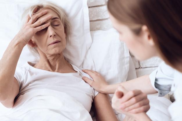 Sick woman has a headache in clinic Premium Photo