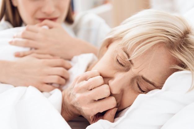 Sick woman not sleeping peacefully in hospital Premium Photo