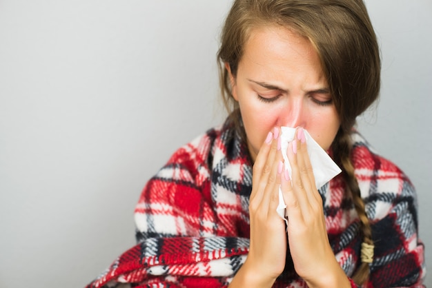 Sick woman wiping a nose Premium Photo