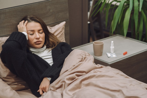 Sick woman with headache sitting at home Free Photo
