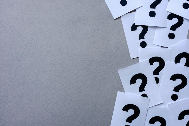 Side border of printer question marks on paper Premium Photo
