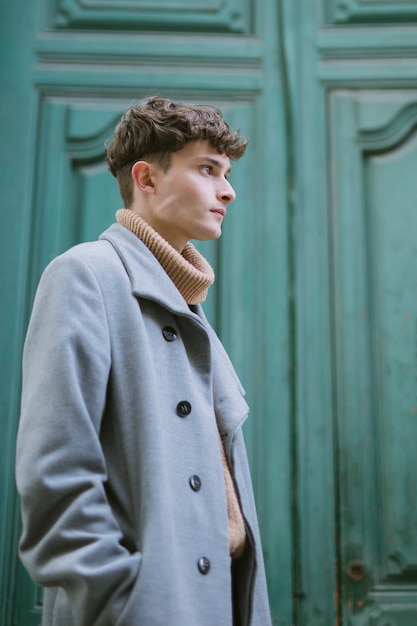 Side profile young man with coat Free Photo