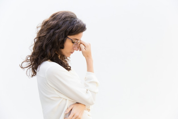 Side of tired sad office worker in glasses with closed eyes Free Photo