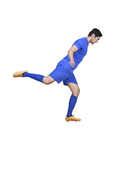 Side view of asian football player kicking the ball Premium Photo