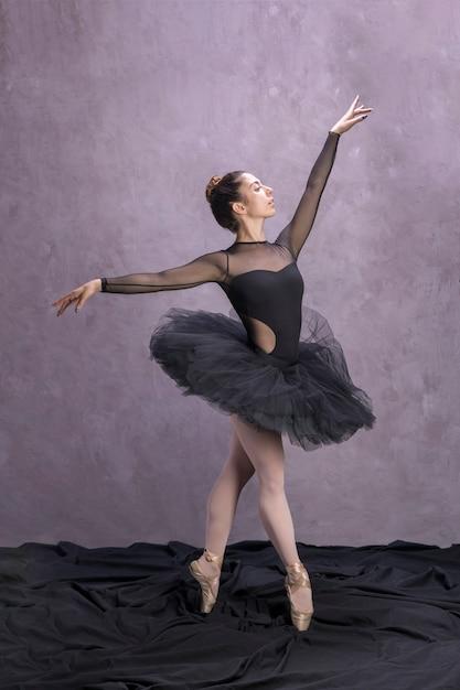 Side view ballerina posing in tutu Free Photo