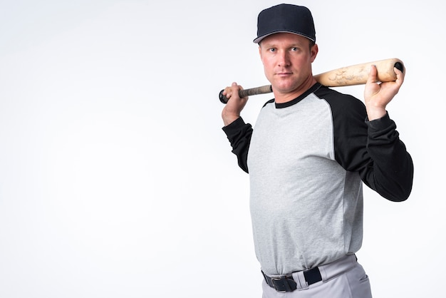 Side view of baseball player with cap and bat Free Photo
