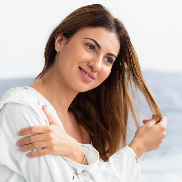 Side view of beautiful woman in bathrobe Free Photo