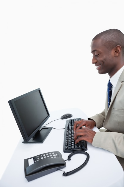 Side view of a businessman using a computer Premium Photo