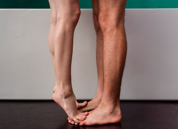 Side view of couple barefoot in bathroom Free Photo