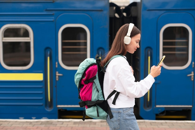 Side view cute girl at the railway station Free Photo