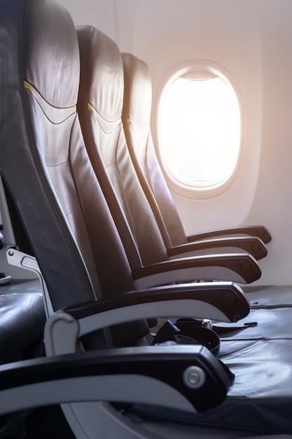 Side view of empty airplane seat in the airplane before take off Premium Photo