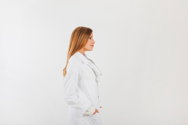 Side view of female doctor Free Photo