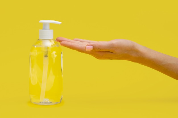 Side view of hand using liquid soap Free Photo