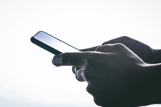 Side view of hands is touching the screen against a white background. Premium Photo