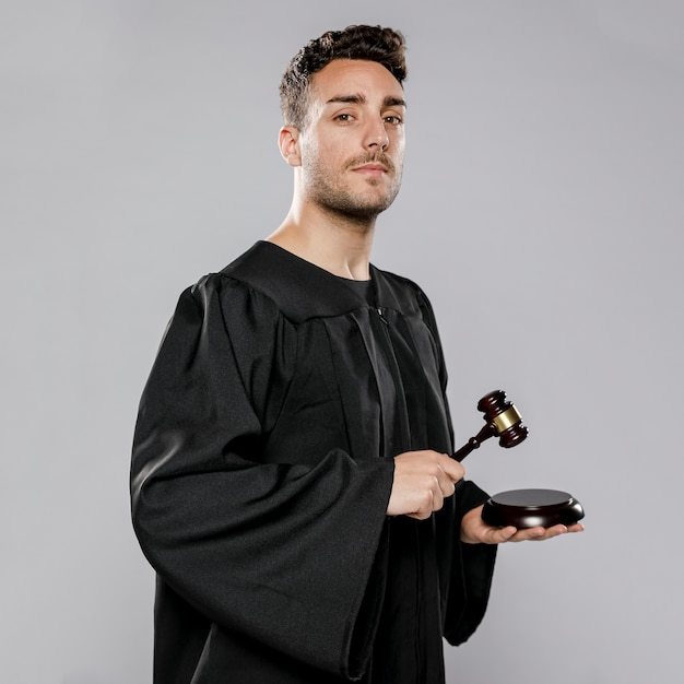 Side view of male judge with gavel Free Photo