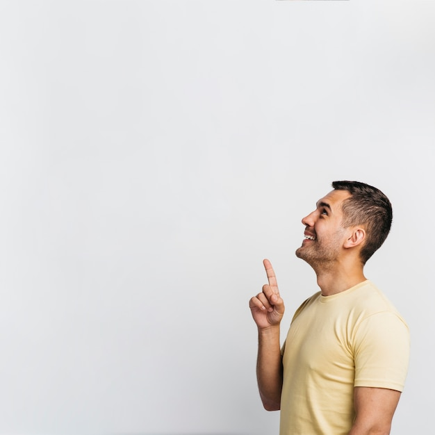 Side view man pointing up with copy space Free Photo