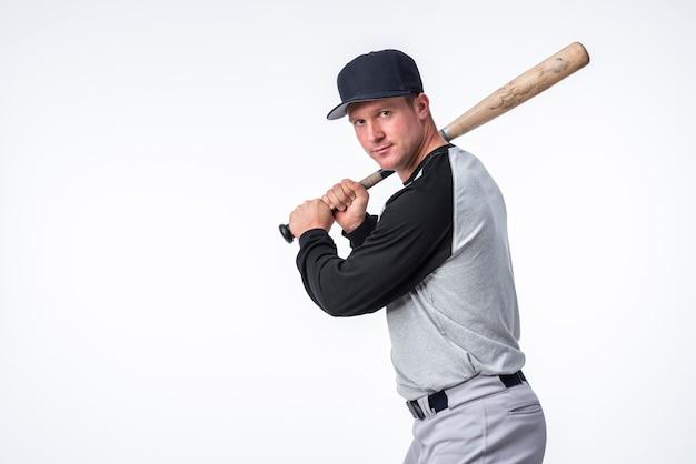 Side view of man posing with baseball bat Premium Photo