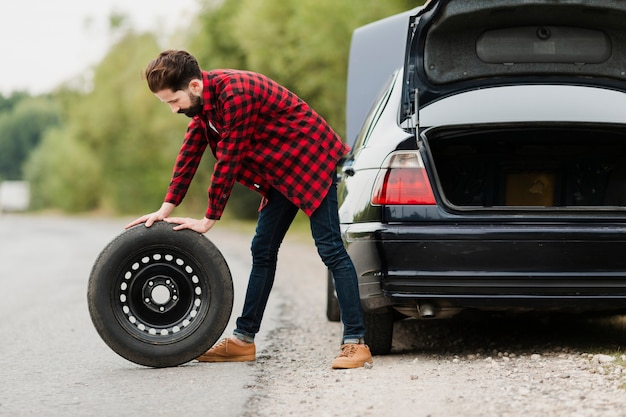 Side view of man with spare tyre Free Photo