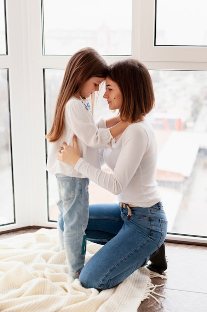 Side view mother and daughter Free Photo