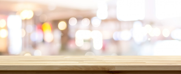 Side view of natural wood pattern table top against blurred bokeh background Premium Photo