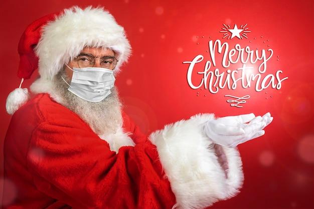 Вид сбоку человека в костюме санта-клауса в медицинской маске Premium Фотографии