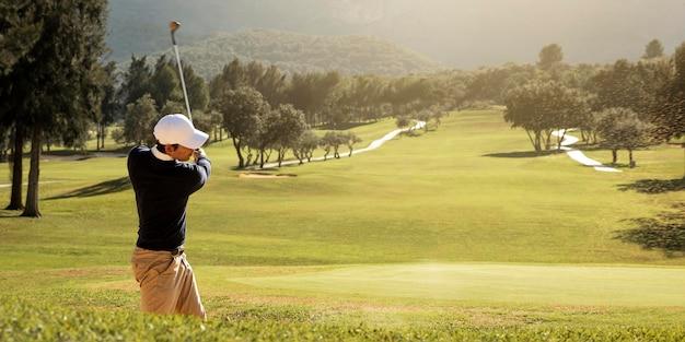 남자 골프의 측면보기 무료 사진