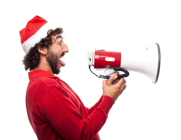 Side view of playful man with a megaphone Free Photo