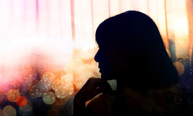 Side view portrait of a sadness woman Premium Photo