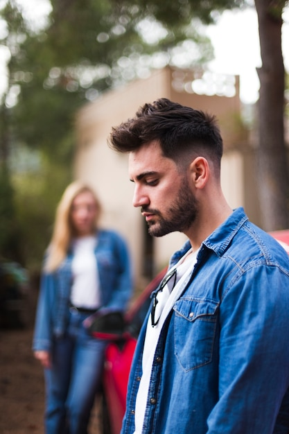 Side view of a sad young man Free Photo