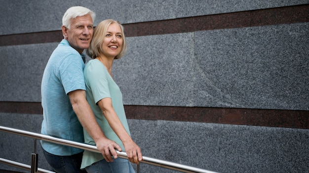 Side view of senior couple posing together outdoors Free Photo